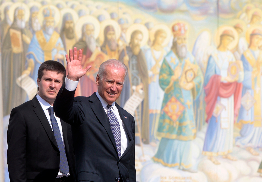 """. U.S. Vice President Joe Biden, right, walking near St. Michael\'s Cathedral in Kiev, Ukraine, Tuesday, April. 22, 2014. Biden warned Russia on Tuesday that \""""it\'s time to stop talking and start acting\"""" to reduce tension in Ukraine, offering a show of support for the besieged nation as an international agreement aimed at stemming its ongoing crisis appeared in doubt. (AP Photo/Sergei Chuzavkov)"""