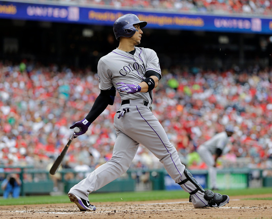 . Colorado Rockies\' Carlos Gonzalez hits a single to load the bases in the fourth inning of a baseball game against the Washington Nationals at Nationals Park, Sunday, June 23, 2013, in Washington. The Rockies won 7-6. (AP Photo/Carolyn Kaster)