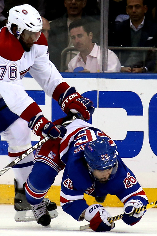 . Martin St. Louis #26 of the New York Rangers is knocked to the ice by P.K. Subban #76 of the Montreal Canadiens during Game Six of the Eastern Conference Final in the 2014 NHL Stanley Cup Playoffs at Madison Square Garden on May 29, 2014 in New York City.  (Photo by Bruce Bennett/Getty Images)