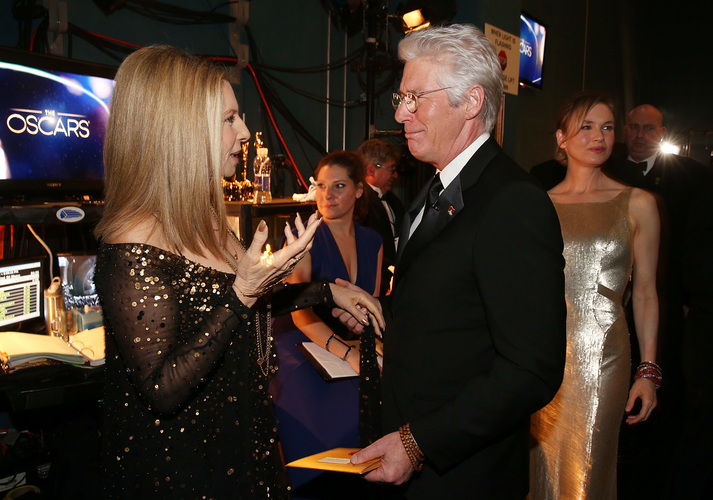 . Singer Barbra Streisand (L) and actor Richard Gere backstage during the Oscars held at the Dolby Theatre on February 24, 2013 in Hollywood, California.  (Photo by Christopher Polk/Getty Images)