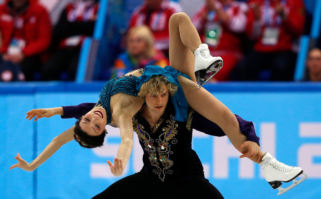 . US Meryl Davis and US Charlie White perform in the Figure Skating Team Ice Dance Free Dance at the Iceberg Skating Palace during the Sochi Winter Olympics on February 9, 2014.   ADRIAN DENNIS/AFP/Getty Images