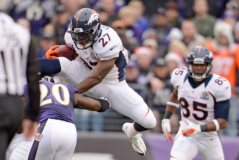 . Denver Broncos running back Knowshon Moreno (27) tries to leap over Baltimore Ravens free safety Ed Reed (20)  during the first quarter Sunday, December 16, 2012 at M&T Bank Stadium. John Leyba, The Denver Post