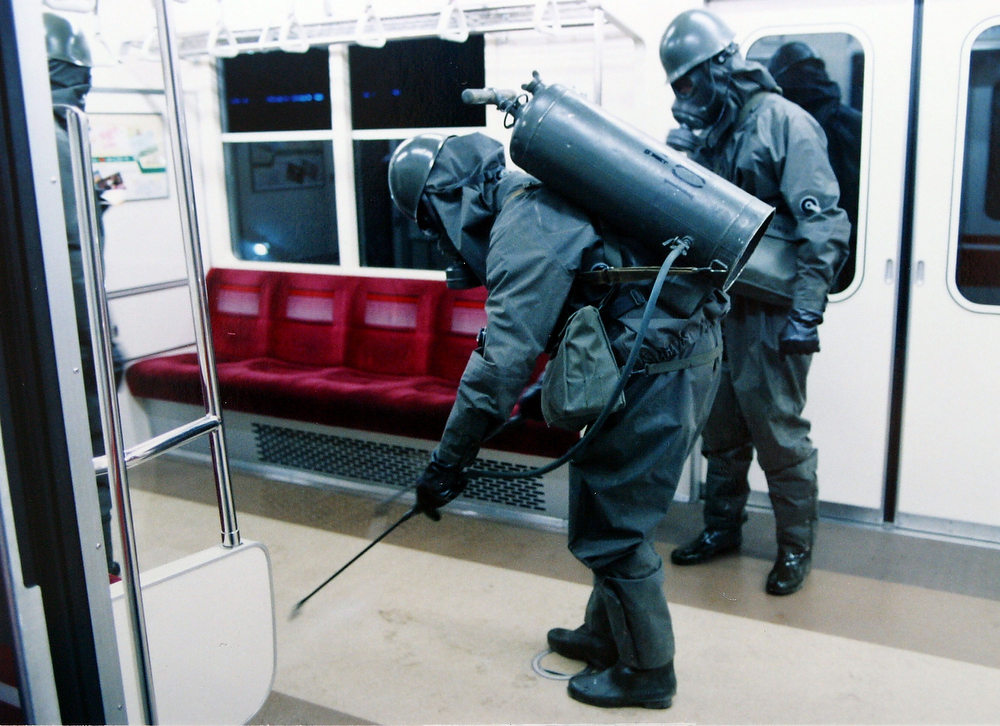 . Personnel of the Self Defense Agency are seen clearing Sarin off platforms after the 1995 Sarin gas attack on Tokyo\'s subways.  Shoko Asahara, real name Chizuo Matsumoto, along with 12 other members of the Aum Supreme Truth doomsday cult, face the gallows after Japan\'s top court rejected the final appeal on November 21, 2011 against a death sentence meted out for the deadly 1995 nerve gas attack on the Tokyo subway. Asahara was charged with masterminding the 1995 Tokyo Sarin attack in which 12 people died and a further 5,000 were poisoned.  (Photo by Japanese Defence Agency/Getty Images)