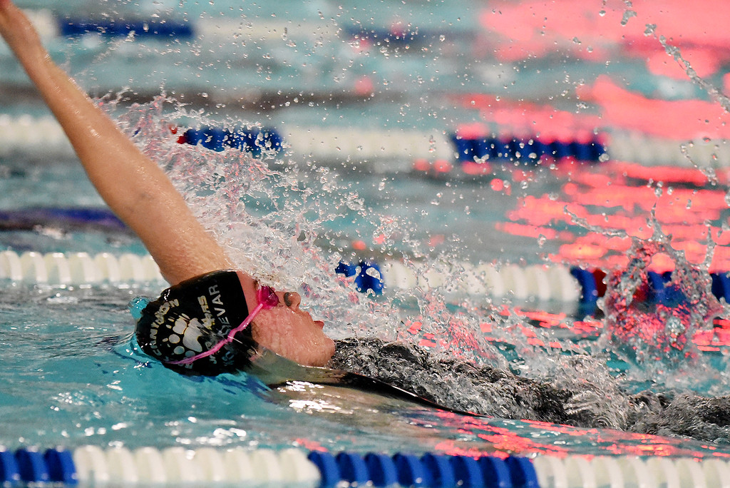 . Rock Canyon\'s Abigail Kochevar won the 100 Yard Backstroke at the girls 5A State Swim meet held at Edora Pool and Ice Center on Saturday. (Photo by Kira Horvath/ The Denver Post)