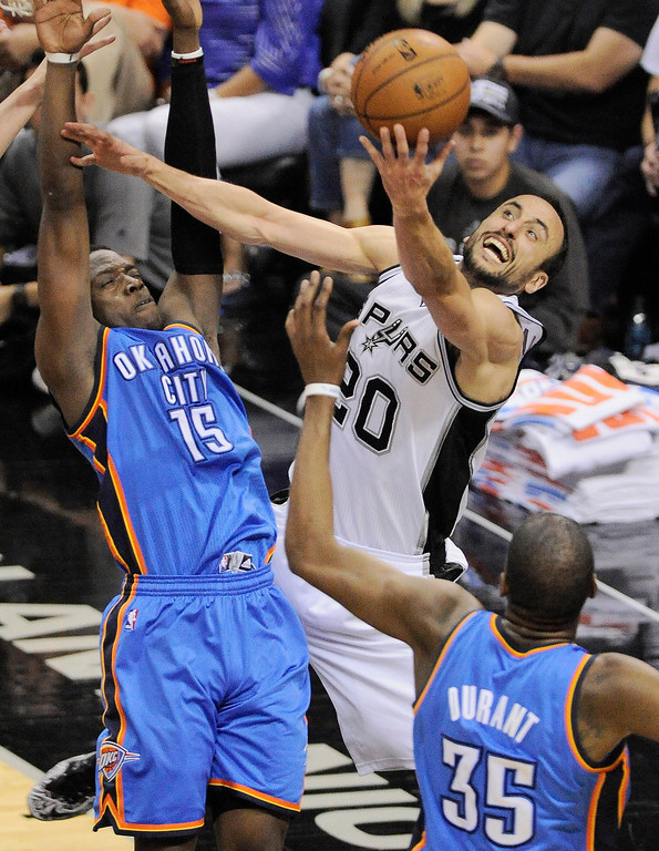 . San Antonio Spurs guard Manu Ginobili, center, of Argentina, shoots against Oklahoma City Thunder guard Reggie Jackson, left, and Thunder forward Kevin Durant, during the second half of Game 2 of a Western Conference finals NBA basketball playoff series, Wednesday, May 21, 2014, in San Antonio. San Antonio won 112-77. (AP Photo/Darren Abate)
