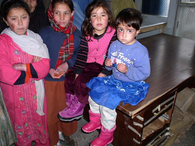 Look at these little girls and their new boots. The one in blue burst into tears after this, thinking (I guess) that she was going to be separated from her beloved plastic sandals. 3 year old thinking !! Very healthy. This was taken in the hospital at the entrance way. Notice that three out of four children are suffering from the skin disorder, leischmaniasis
