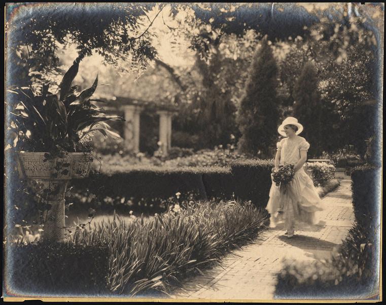 Ninah Cummer in English Garden 1929.jpg