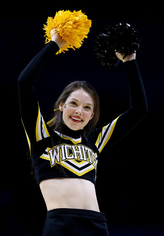 . A Wichita State Shockers cheerleader performs during the second round of the 2014 NCAA Men\'s Basketball Tournament against the Cal Poly Mustangs at the Scottrade Center on March 21, 2014 in St Louis, Missouri.  (Photo by Andy Lyons/Getty Images)