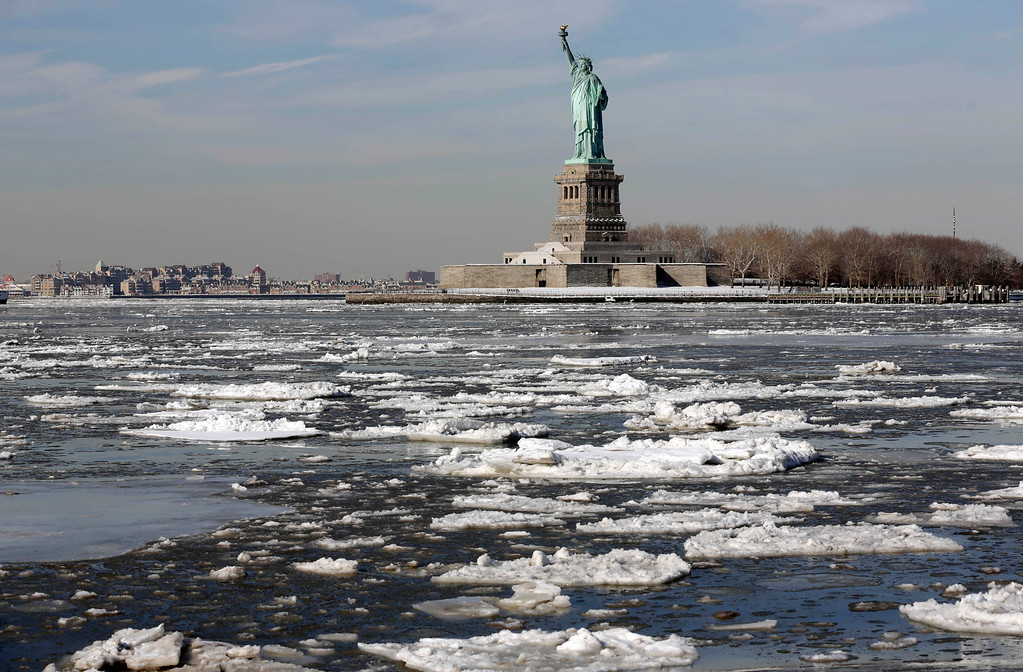 . Ice flows past the Statue of Liberty, Tuesday, Feb. 24, 2015, in New York. (AP Photo/Richard Drew)