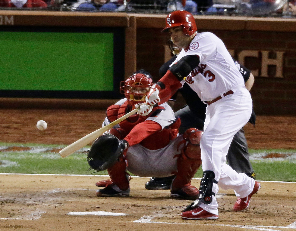 . St. Louis Cardinals\' Carlos Beltran hits a single during the second inning of Game 5 of baseball\'s World Series against the Boston Red Sox Monday, Oct. 28, 2013, in St. Louis. (AP Photo/Charlie Riedel)