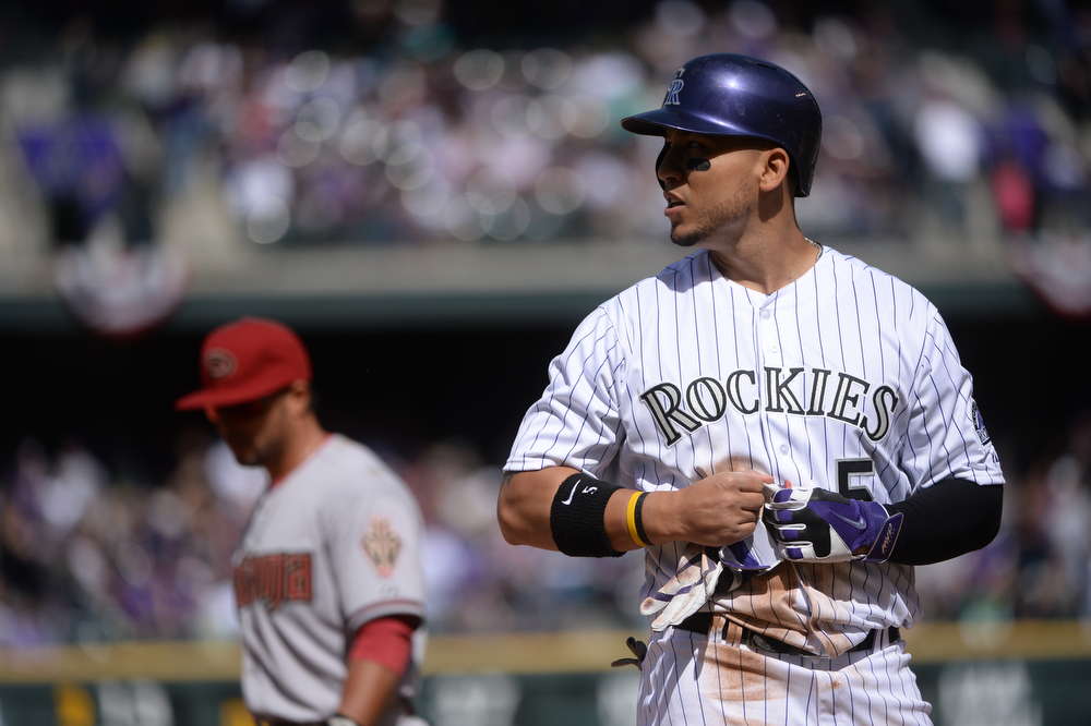 . Carlos Gonzalez stays at third base after hitting a triple in the third inning. The Colorado Rockies hosted the Arizona Diamondbacks in the Rockies season home opener at Coors Field in Denver, Colorado Friday, April 4, 2014. (Photo by Karl Gehring/The Denver Post)