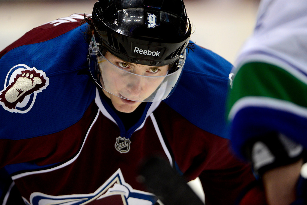 . DENVER, CO - MARCH 24: Matt Duchene (9) of the Colorado Avalanche takes a face off against the Vancouver Canucks during the third period of action. The Colorado Avalanche lost to the Vancouver Canucks 3-2 at the Pepsi Center. (Photo by AAron Ontiveroz/The Denver Post)