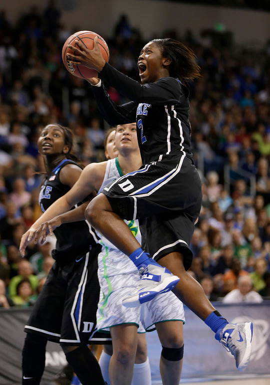 . Duke guard Alexis Jones (2) takes a shot in front of Notre Dame guard Kayla McBride during the first half of the regional final game of the NCAA women\'s college basketball tournament Tuesday, April 2, 2013, in Norfolk, Va. (AP Photo/Steve Helber)