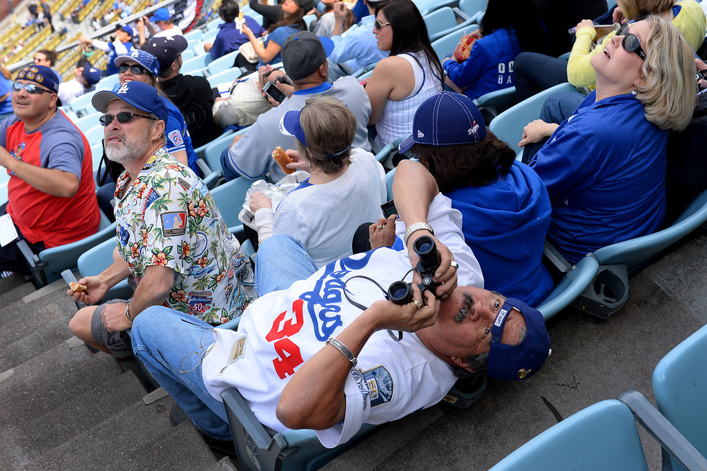 . People watch the skydivers at the Dodgers home opener, Friday, April 4, 2014, at Dodger Stadium. (Photo by Michael Owen Baker/L.A. Daily News)