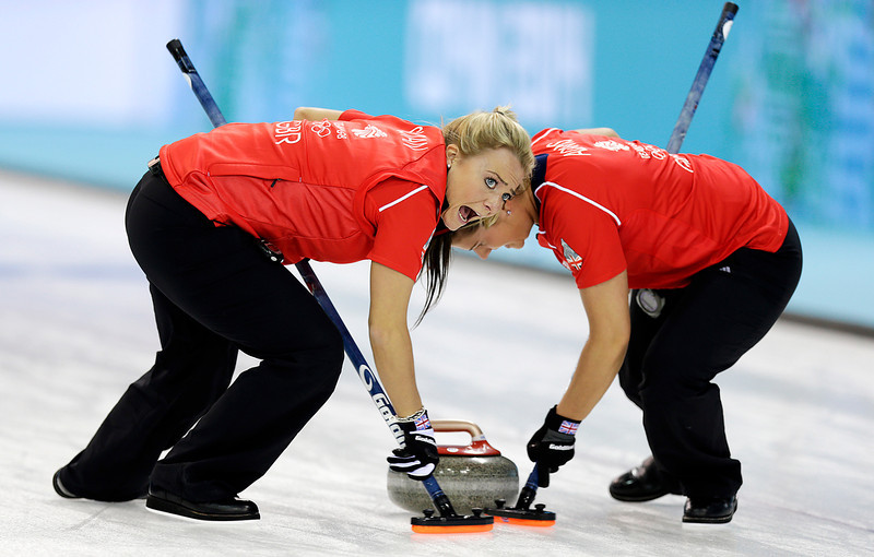 . Great Britain\'s Anna Sloan, left, and Vicki Adams, right, sweep the ice during the women\'s curling competition against the United States at the 2014 Winter Olympics, Tuesday, Feb. 11, 2014, in Sochi, Russia. (AP Photo/Wong Maye-E)