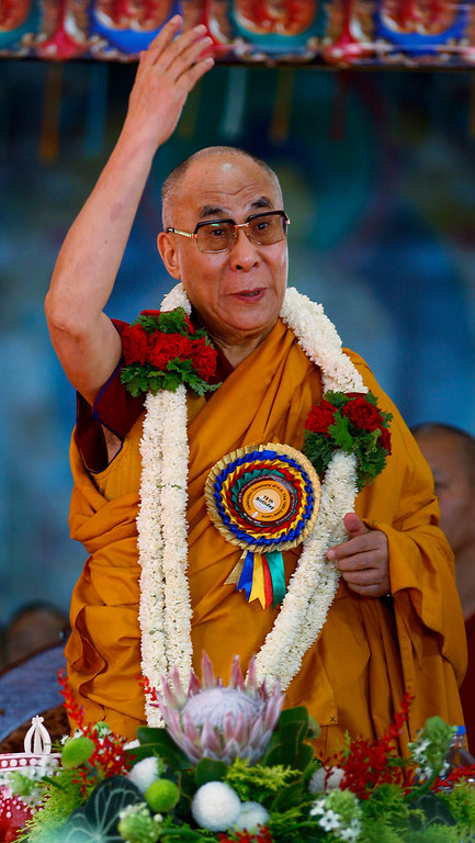 . Tibetan spiritual leader the Dalai Lama gestures during an event organized to celebrate his 78th birthday at a Tibetan Buddhist monastery in Bylakuppe, about 220 kilometers (137 miles) southwest of Bangalore, India, Saturday, July 6, 2013. (AP Photo/Aijaz Rahi)