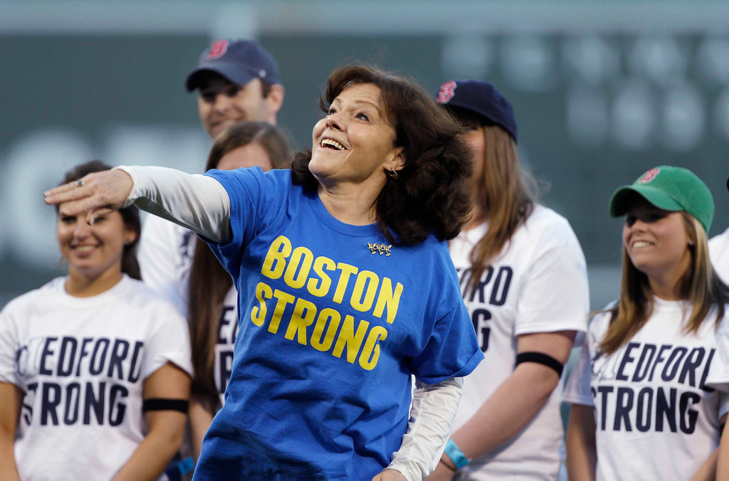. Patty Campbell, of Medford, Mass., mother of Krystle Campbell, who was killed in the Boston Marathon bombing, throws out a ceremonial first pitch prior to a baseball game between the Boston Red Sox and the Minnesota Twins at Fenway Park in Boston, Tuesday, May 7, 2013. (AP Photo/Elise Amendola)