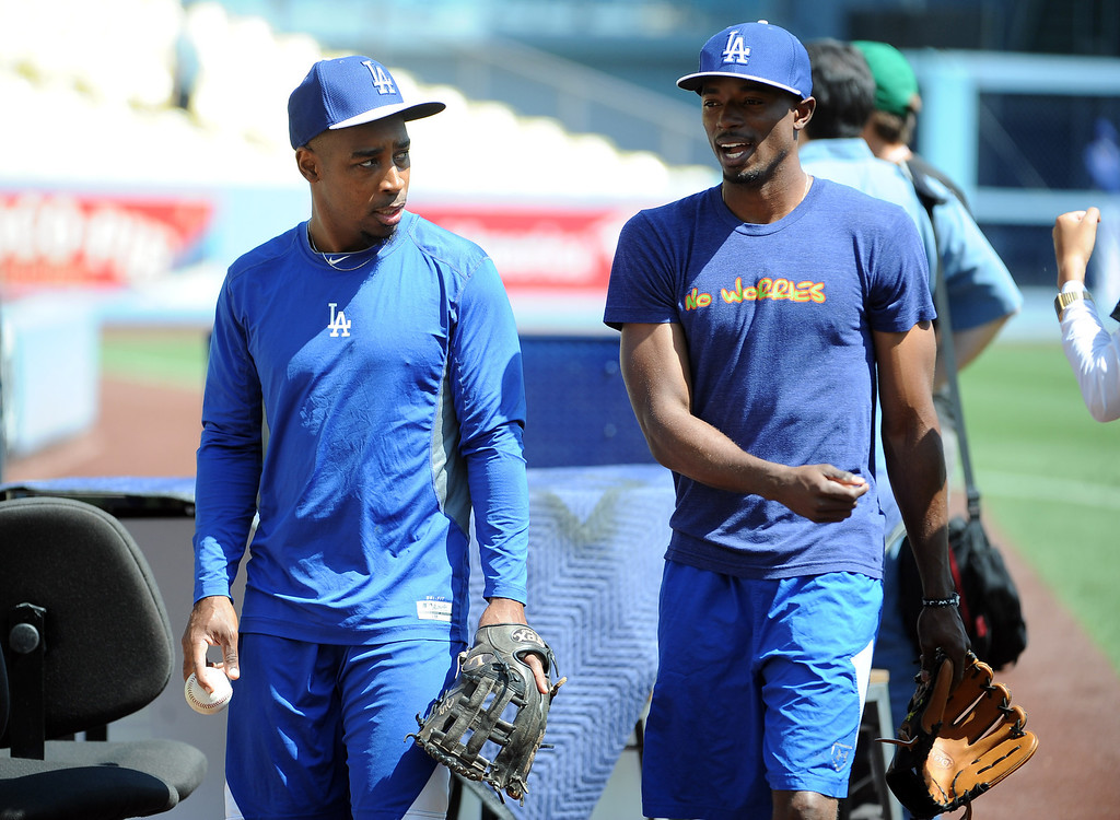 . Los Angeles Dodgers\' Dee Gordon, right, with Chone Figgins prior to a Major league baseball game against the San Francisco Giants on Saturday, May10, 2013 in Los Angeles.   (Keith Birmingham/Pasadena Star-News)