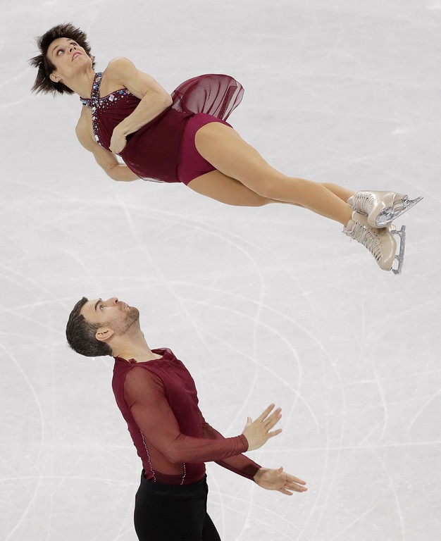 . Meagan Duhamel and Eric Radford of Canada perform in the team event pair skating in the Gangneung Ice Arena at the 2018 Winter Olympics in Gangneung, South Korea, Sunday, Feb. 11, 2018. (AP Photo/David J. Phillip)