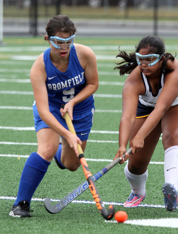 . Littleton vs Bromfield field hockey. Bromfield\'s Jordan Hoover (9) and Littleton\'s Radhika Mehta (19).  (SUN/Julia Malakie)