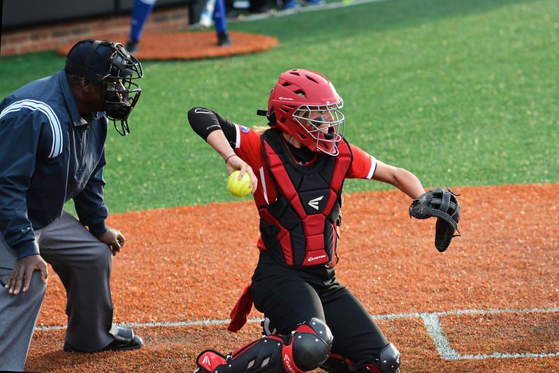 Rachel Comiskey throwing a ball back