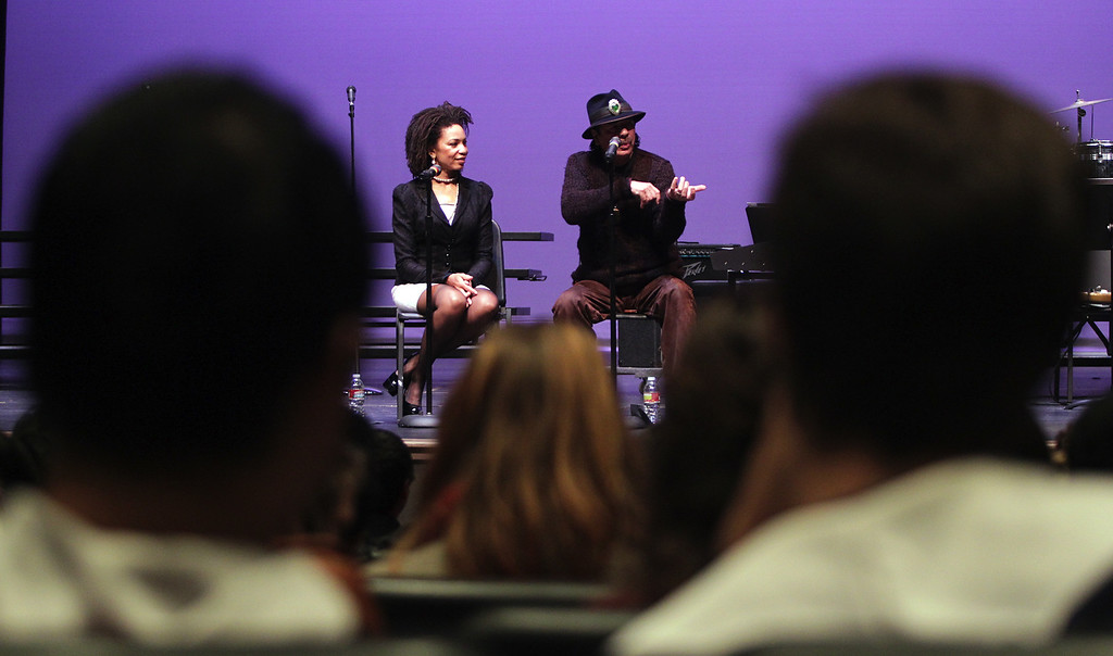 . Cindy Blackman Santana and husband Carlos Santana, from left, speak to music students at San Leandro High School in San Leandro, Calif., on Wednesday, Jan. 9, 2013. (Anda Chu/Staff)