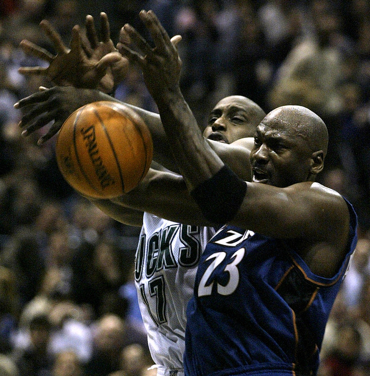 . Washington Wizards\' Michael Jordan, right and Milwaukee Bucks\' Anthony Mason, left fight for a rebound in the first half Thursday Jan. 30, 2003 in Milwaukee.  (AP Photo/ Darren Hauck)
