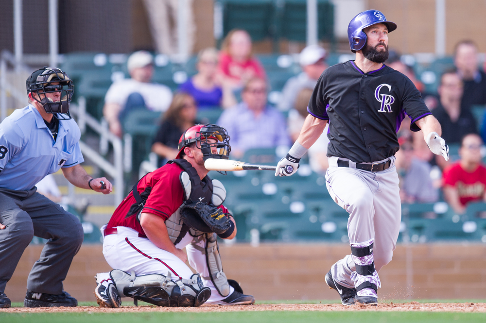 . Jason Pridie #26 of the Colorado Rockies hits a home run during a spring training game against the Arizona Diamondbacks of the Colorado Rockies at Salt River Fields at Talking Stick on February 28, 2014 in Scottsdale, Arizona. (Photo by Rob Tringali/Getty Images)