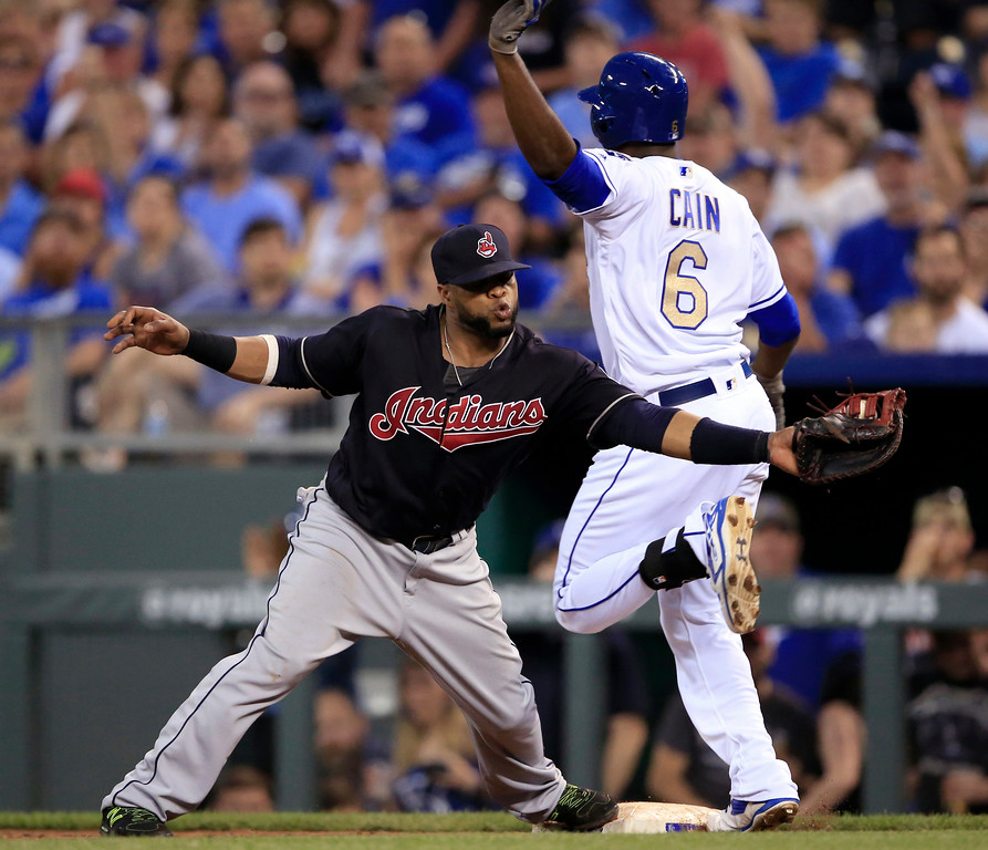 . Kansas City Royals\' Lorenzo Cain (6) beats the throw to Cleveland Indians first baseman Carlos Santana during the sixth inning of a baseball game at Kauffman Stadium in Kansas City, Mo., Friday, June 2, 2017. Cain was ruled safe on the play after review. Royals\' Alcides Escobar scored on the play. (AP Photo/Orlin Wagner)