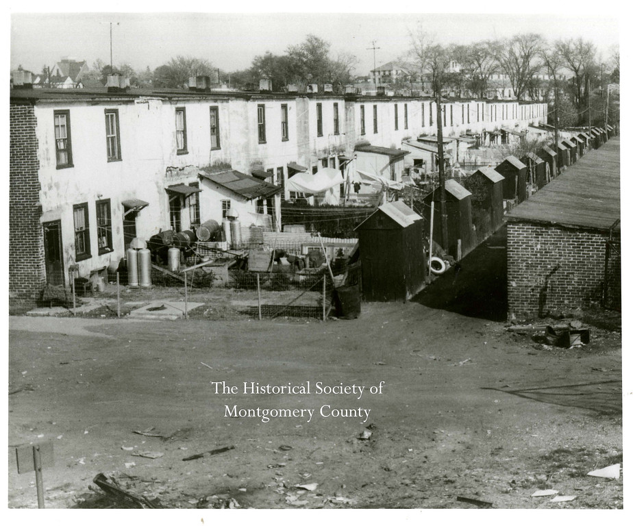 ". The photo from the Historical Society of Montgomery County shows ""Gariabldi�s Row� in Ambler.  The home were built by Keasby and Mattison Company for their employees. This picture was taken just before they were demolished in 1961."