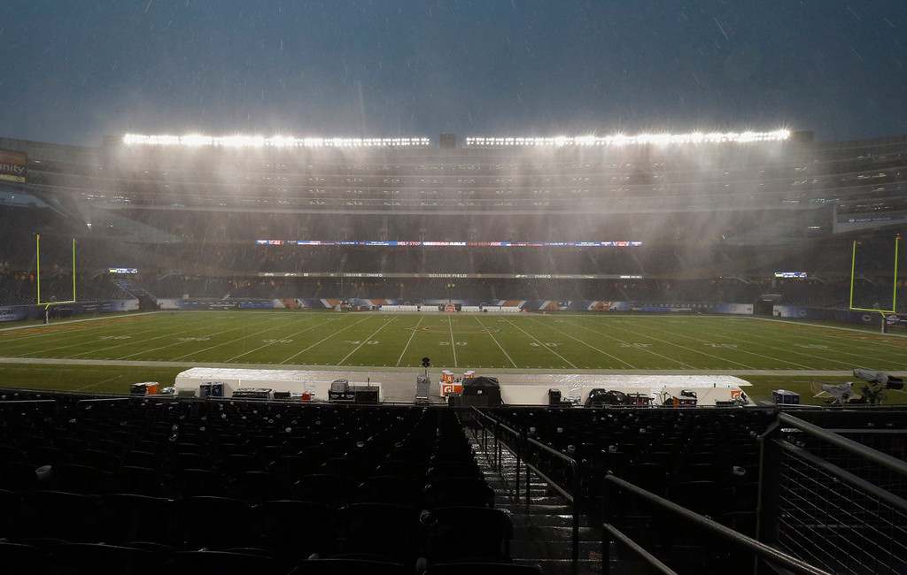 . Heavy rain falls as play was suspended during the first half of an NFL football game between the Chicago Bears and Baltimore Ravens, Sunday, Nov. 17, 2013, in Chicago. (AP Photo/Nam Y. Huh)