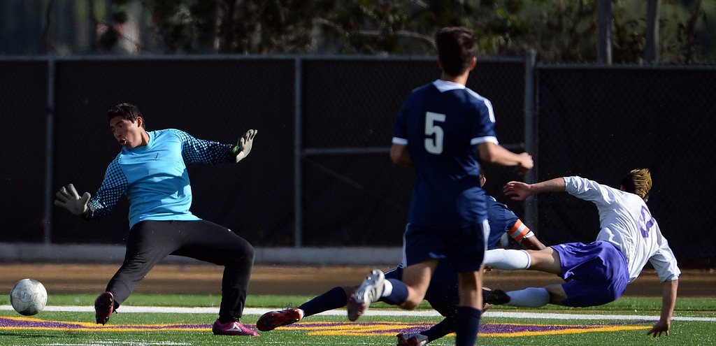 . Diamond Bar\'s Guy Horcasitas (8) scores past Baldwin Park goal keeper Joshua Luna in the first half of a CIF-SS quarterfinal prep playoff soccer match at Diamond Bar High School in Diamond Bar, Calif., on Thursday, Feb.27, 2014. Baldwin Park won 2-1. (Keith Birmingham Pasadena Star-News)