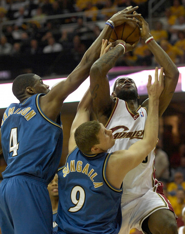. Michael Blair/MBlair@News-Herald.com The Cavs LeBron James is fouled hard as he goes to the basket past the Wizard\'s Antawn Jamison and Darius Songaila during the first quarter of Wednesday\'s 88-87 loss to the Wizards at The Q.