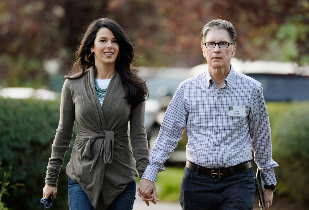 . John W. Henry, owner of  Boston Red Sox, and his wife Linda Pizzuti arrive for the Allen & Co. annual conference at the Sun Valley Resort on July 10, 2013 in Sun Valley, Idaho. The resort is hosting corporate leaders for the 31st annual Allen & Co. media and technology conference where some of the wealthiest and most powerful executives in media, finance, politics and tech gather for weeklong meetings. Past attendees included Warren Buffett, Bill Gates and Mark Zuckerberg.  (Photo by Kevork Djansezian/Getty Images)