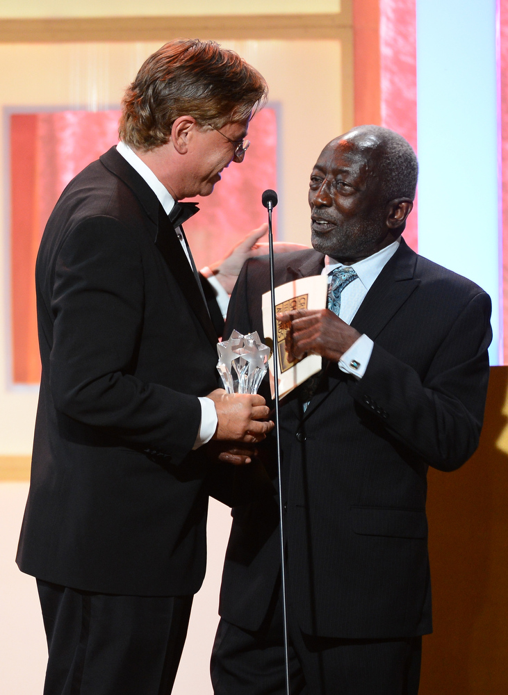 """. Writer/producer Aaron Sorkin accepts the Best Guest Performer in a Drama Series award for \""""The Newsroom\"""" from actor Garrett Morris on behalf of actress Jane Fonda onstage during Broadcast Television Journalists Association\'s third annual Critics\' Choice Television Awards at The Beverly Hilton Hotel on June 10, 2013 in Los Angeles, California.  (Photo by Mark Davis/Getty Images for CCTA)"""