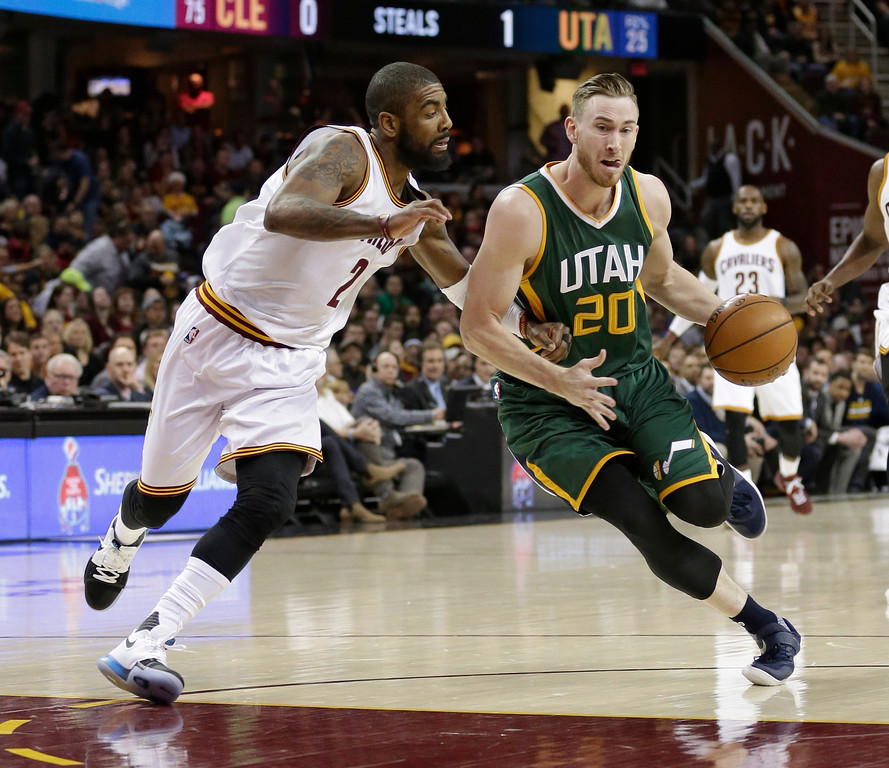 . Utah Jazz\'s Gordon Hayward (20) drives past Cleveland Cavaliers\' Kyrie Irving (2) in the first half of an NBA basketball game, Thursday, March 16, 2017, in Cleveland. (AP Photo/Tony Dejak)