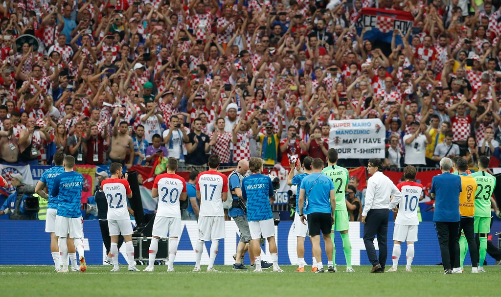 . Croatian players acknowledge the applause of their supporters at the end of the final match between France and Croatia at the 2018 soccer World Cup in the Luzhniki Stadium in Moscow, Russia, Sunday, July 15, 2018. France won 4-2. (AP Photo/Petr David Josek)