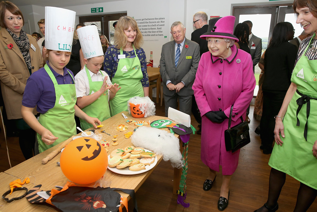 . HRH Queen Elizabeth II meets children making halloween cakes as she visits the new 68 bed YHA South Downs hostel at YHA South Downs on October 31, 2013 in Lewes, England.  (Photo by Chris Jackson/Getty Images)