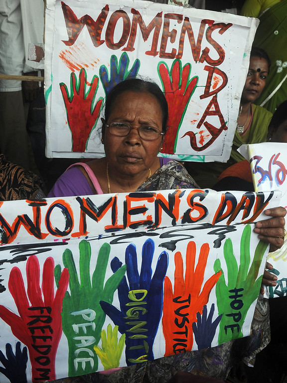 . Indian female labourers and sex workers pose with placards for a rally on International World Women\'s day  in Kolkata on March 8, 2013. The demonstrators participated in the rally to demand equal social and finacial rights and securitys.  DIBYANGSHU SARKAR/AFP/Getty Images