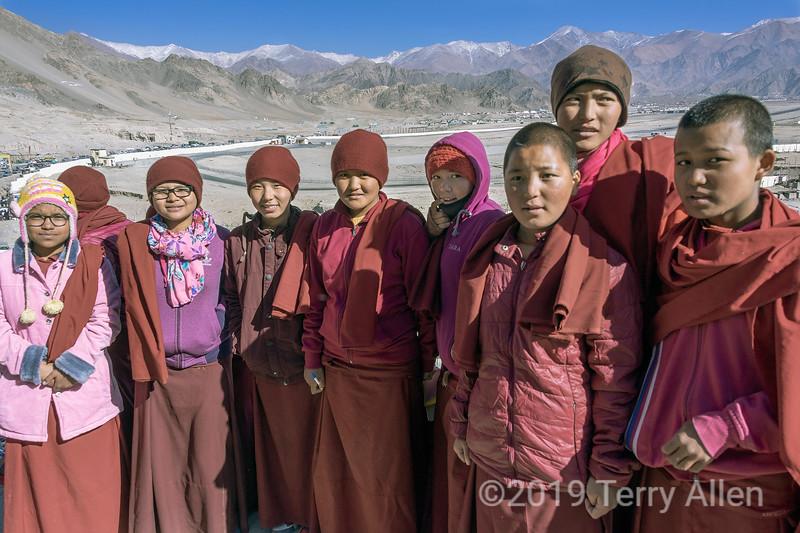 Group of monks posing at Spituk Gompa at the Gustor festival, Ladakh range in background, Leh, Ladakh.jpg