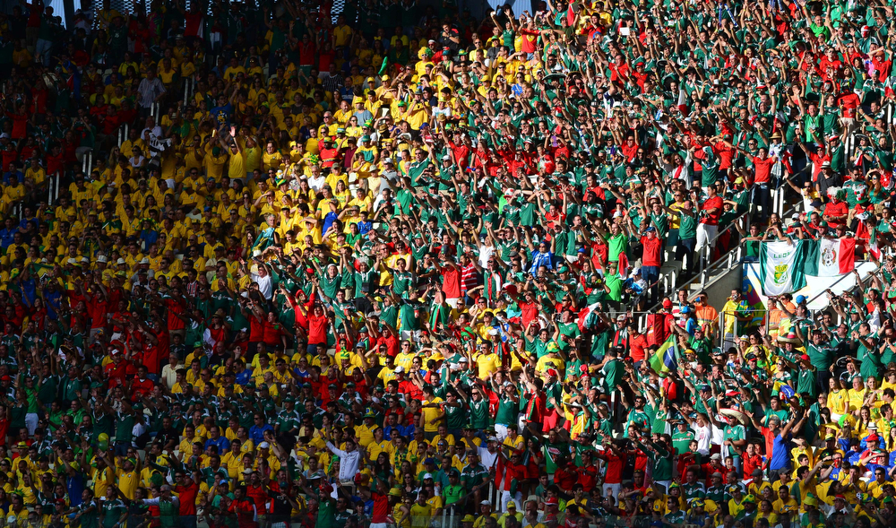 . Football fans cheer during a Group A football match between Brazil and Mexico in the Castelao Stadium in Fortaleza during the 2014 FIFA World Cup on June 17, 2014.  (YURI CORTEZ/AFP/Getty Images)