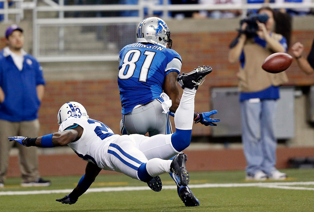 Description of . Detroit Lions wide receiver Calvin Johnson (81), defended by Indianapolis Colts cornerback Vontae Davis (23), prepares to catch a 46-yard pass for a touchdown during the third quarter of an NFL football game at Ford Field in Detroit, Sunday, Dec. 2, 2012. (AP Photo/Rick Osentoski)