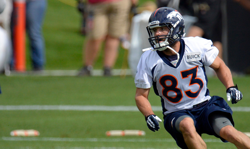 . Denver Broncos WR We Welker (83) runs a route during opening day of training camp July 25, 2013 at Dove Valley. (Photo By John Leyba/The Denver Post)