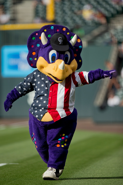 . Colorado Rockies mascot Dinger walks on the field before a game against the Los Angeles Dodgers at Coors Field on July 3, 2014 in Denver, Colorado.  (Photo by Justin Edmonds/Getty Images)