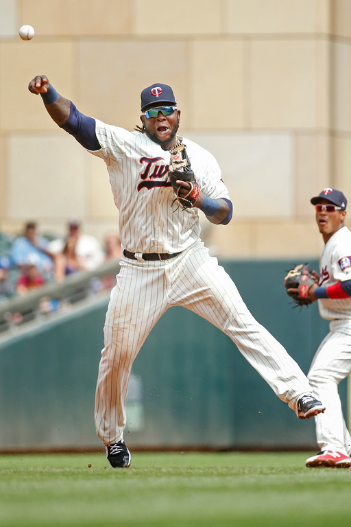 . Minnesota Twins third baseman Miguel Sano throws to first for the out after fielding a ground ball hit by Cleveland Indians\' Jose Ramirez in the fourth inning of a baseball game Wednesday, Aug. 1, 2018, in Minneapolis. The Indians won 2-0. (AP Photo/Bruce Kluckhohn)