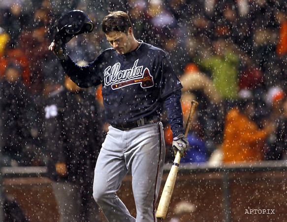 The Atlanta Braves' Matt Diaz strikes out against the San Francisco Giants' Jeremy Affeldt to end the game, just as the rain begins to fall in an MLB baseball game, Sunday, April 11, 2010 in San Francisco.  (AP Photo/Dino Vournas)