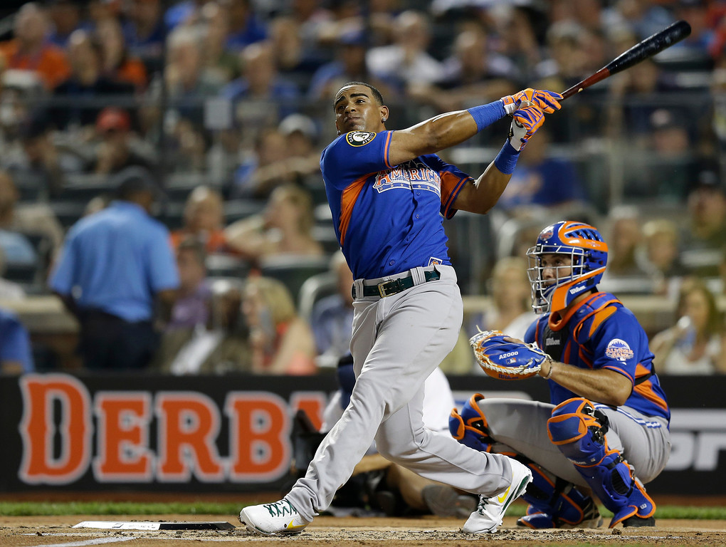 . American League\'s Yoenis Cespedes, of the Oakland Athletics, hits home run during the MLB All-Star baseball Home Run Derby, on Monday, July 15, 2013 in New York. (AP Photo/Kathy Willens)