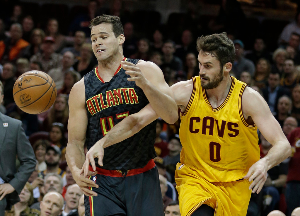 . Atlanta Hawks\' Kris Humphries (43) and Cleveland Cavaliers\' Kevin Love (0) battle for the ball in the first half of an NBA basketball game, Friday, April 7, 2017, in Cleveland. (AP Photo/Tony Dejak)