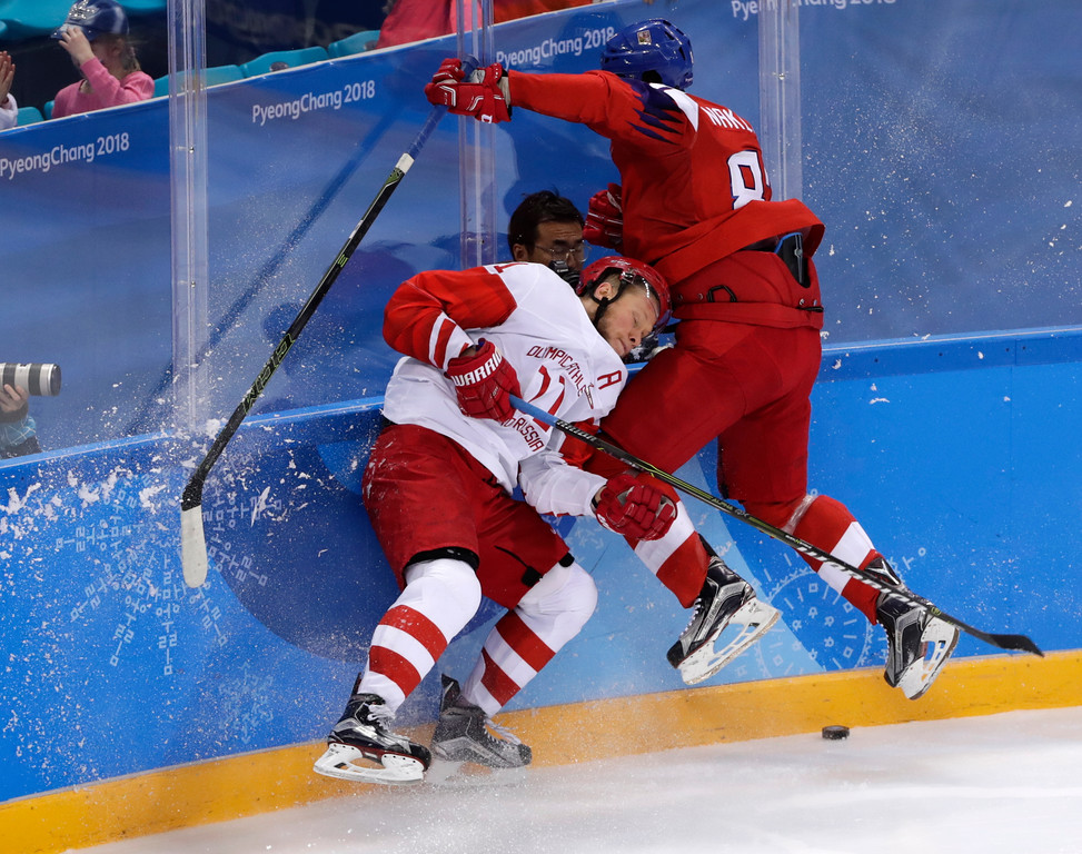 . Russian athlete Sergei Andronov (11) and Jakub Nakladal (87), of the Czech Republic, collide during the second period of the semifinal round of the men\'s hockey game at the 2018 Winter Olympics in Gangneung, South Korea, Friday, Feb. 23, 2018. (AP Photo/Frank Franklin II)