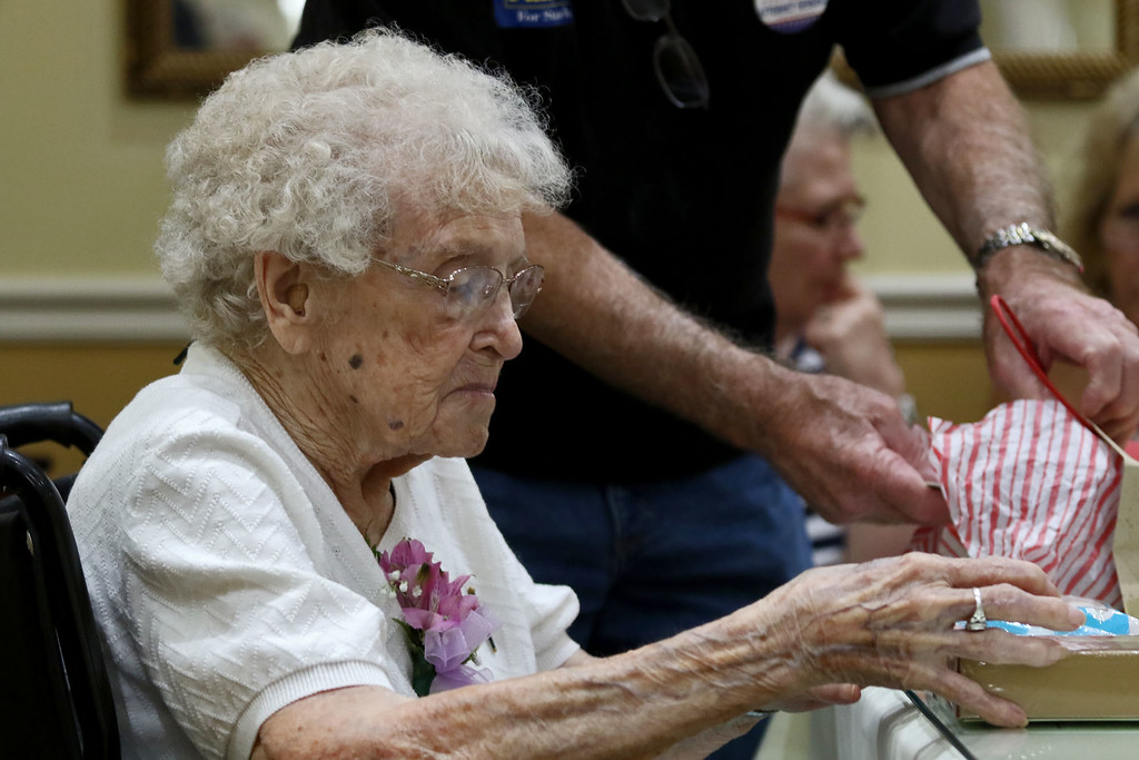 . Norma Schofield had her 106 birthday on Tuesday, September 12, 2018 at Manor On the Hill in Leominster where she now lives. Norma opens up her birthday gifts. SENTINEL & ENTERPRISE/JOHN LOVE